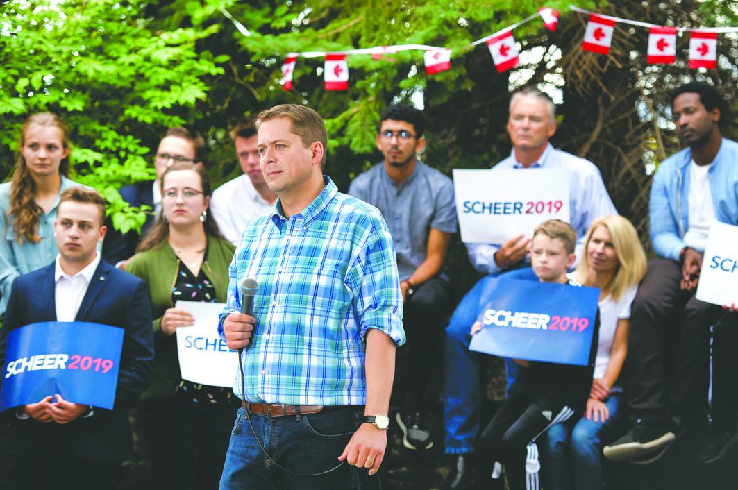 谢尔在渥太华集会上回答选民提问。加通社