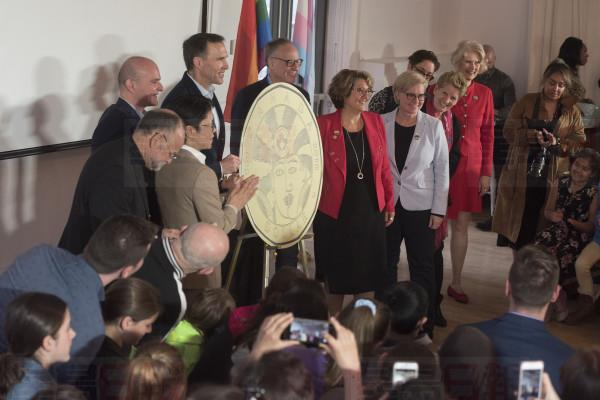 The Royal Canadian Mint unveils the new one-dollar coin honouring the progress made in the journey to equal rights for LGBTQ2 Canadians at a press conference in Toronto on Tuesday, April 23, 2019. THE CANADIAN PRESS/Tijana Martin