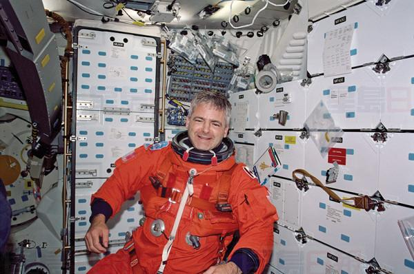 Mission Specialist (MS) Marc Garneau wearing his Launch and Entry Suit (LES) on the middeck of Endeavour, Orbiter Vehicle (OV-105), during re-entry preparations for the STS-97 mission. Garneau represents the Canadian Space Agency (CSA). Image 026 was selected by the STS-97 crew for use in public presentations. NASA